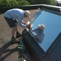 Sonnenschutz - Montage einer Spiegelfolie